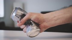 4K - Hand destroying a beer can Stock Footage