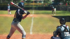 Batter waiting to bat during baseball game with catcher behind him - stock footage