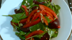 Salad of Spinach Beet Tomatoes and Pumpkin Seeds Stock Footage