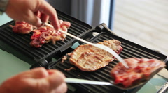 Cooking steak on an electric grill - stock footage