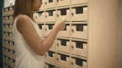 Woman opens mailbox 4k UHD (3840x2160) - stock footage