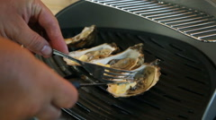 Hot oysters with butter on the grill - stock footage