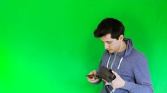 Boy puts mobile and set the 3D VR glasses with green screen Stock Footage