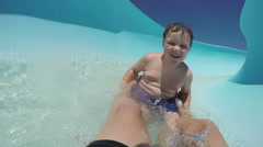 Happy young boy going down waterslide Cape Town Stock Footage