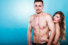 Passionate young people in love, woman and man - stock photo