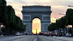 Arc De Triumph at sunset, seen from Champs Elysees Stock Footage