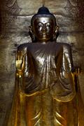 Standing Buddha covered in gold leaf - stock photo