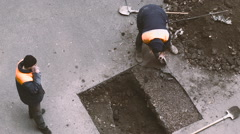 Worker Cuts the Asphalt Saw and Remove the Layer - stock footage