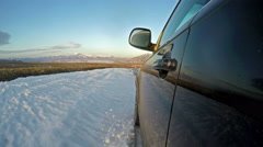 Off-roading with luxury car on a snowy road - stock footage