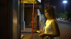 Young Woman buying in street stall at night 4k UHD (3840x2160) Stock Footage