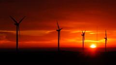 Bright Orange Sunrise Signal Peak Wind Turbines Washington Green Energy - stock footage