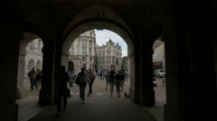 Walking under The Household Cavalry Museum's arched corridor in London Stock Footage