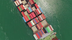 AERIAL: Flying above huge cargo ship fully loaded with containers - stock footage