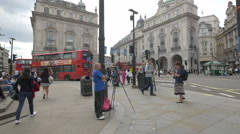 Man filming in Piccadilly Circus, London Stock Footage