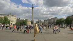 Levitating man and tourists in Trafalgar Square, London Stock Footage