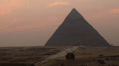 Zoon Out - Time Lapse of Sunset - The Great Pyramids of Giza - Egypt Stock Footage