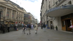 Men and women walking on Coventry Street in London Stock Footage