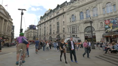 Piccadilly Circus with restaurants and monuments in London Stock Footage