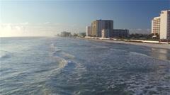 AERIAL: Flying above ocean towards skyscrapers buildings on Miami Beach - stock footage