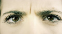 Extreme closeup of angry worried  brown female eyes 4K - stock footage