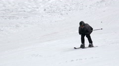 A young man skiing down the slope Stock Footage