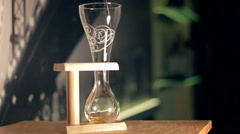 Elite light beer is being poured into a curved glass - stock footage