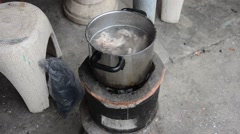 Cooking soup stock on Stove Thai Style - stock footage