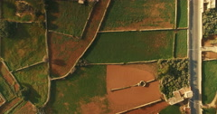 Aerial Shot Looking down over Green Fields Stock Footage
