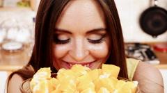 Woman holds bowl full of sliced orange fruits 4K Stock Footage
