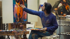 Senior painter holding a palette. creates in his studio Stock Footage