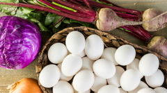 Ingredients for dyeing Easter eggs on a wood table. Stock Footage