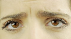 Extreme closeup of beautiful sad brown female eyes closing 4K - stock footage