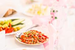 Stock Photo of food preparation  at the indoor wedding. Serving tasteful food, catering