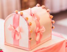Stylish decorated box for gifts at the reception in a restaurant on wedding Stock Photos