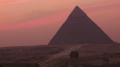 Zoom Out - The Great Pyramids of Giza at Sunset - Egypt - stock footage