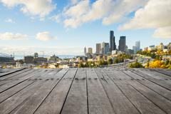 Empty wood floor with cityscape and skyline of seattle Stock Photos