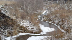 Winding river between hills covered with snow Stock Footage
