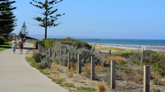 HENLEY BEACH, SOUTH AUSTRALIA -Woman running and people ex - stock footage