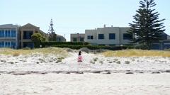 HENLEY BEACH, SOUTH AUSTRALIA -Activity on sunny beach at  Stock Footage