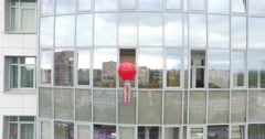 Young Girl With A Red Balloon Sits On The Window - stock footage