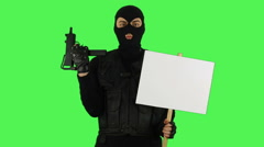 Terrorist with sign on green screen Stock Footage