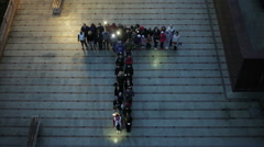 Crowd standing in the form of letters - stock footage