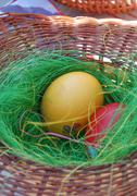 two easter eggs in a basket - stock photo