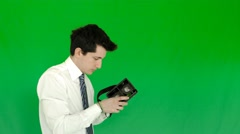 Businessman sets and wearing the 3D VR glasses with green screen Stock Footage
