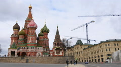 People walk near the Kremlin, St. Basil's Cathedral, Vasilevsky descent Stock Footage