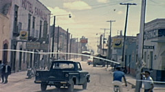 Mexico 1965: driving in the street of a small town Stock Footage