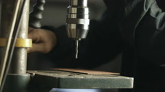 Worker removes metal shavings from the drill Stock Footage