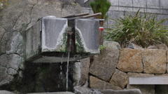 Water flows at a japanese open air hot spring (onsen).. Stock Footage