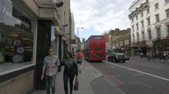 Stock Video Footage of Men and women walking on Borough High Street in the afternoon in London