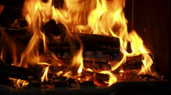 Brightly burning wood in the fireplace - stock footage